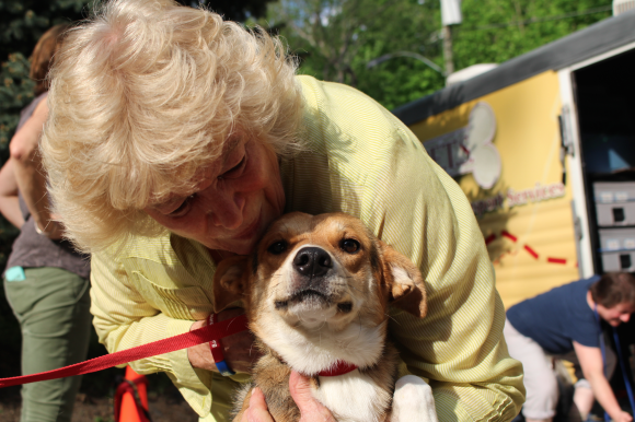 At Northwind Kennels in Bedord, Kerrin Coyle of Greenwich greets a sweet dog straight off the transport from the deep south. Credit: Leslie Yager